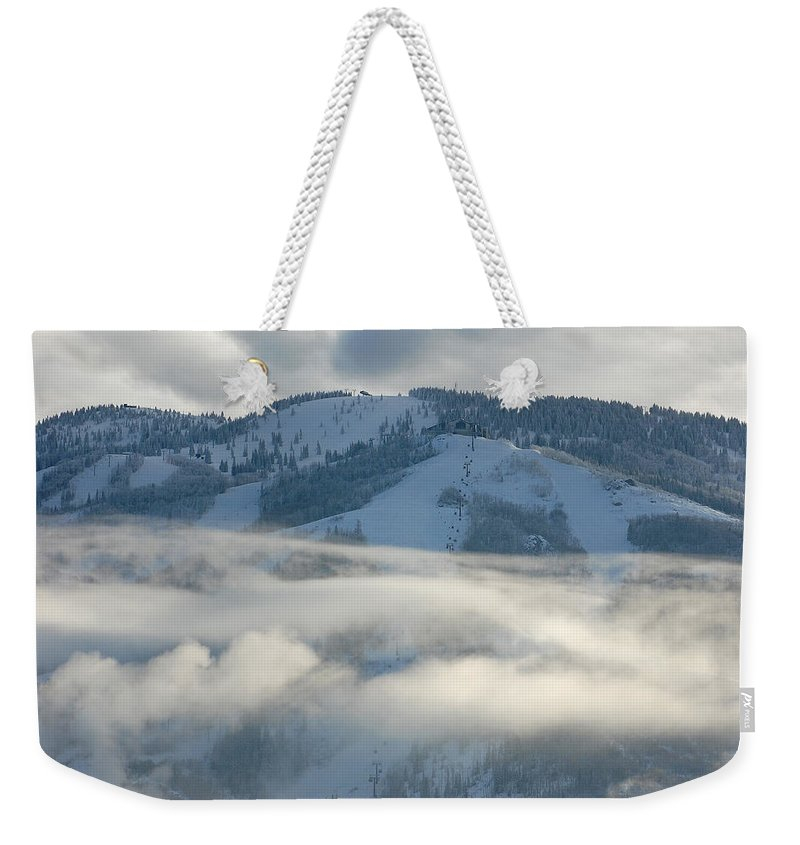 Clouds Weekender Tote Bag featuring the photograph Steamboat Ski Area In Clouds by Don Schwartz