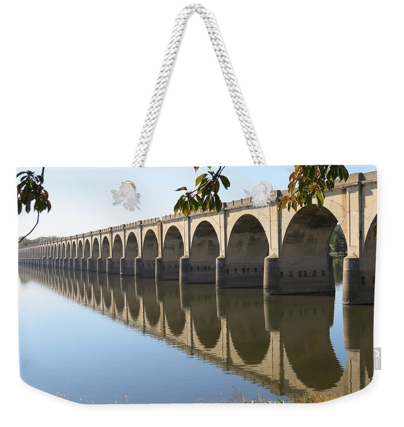 River Weekender Tote Bag featuring the photograph Still Waters by Jean Macaluso
