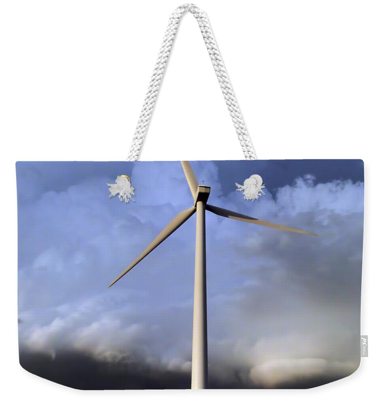 Wind Weekender Tote Bag featuring the photograph Storm Clouds And Wind Turbine by Alan Hutchins