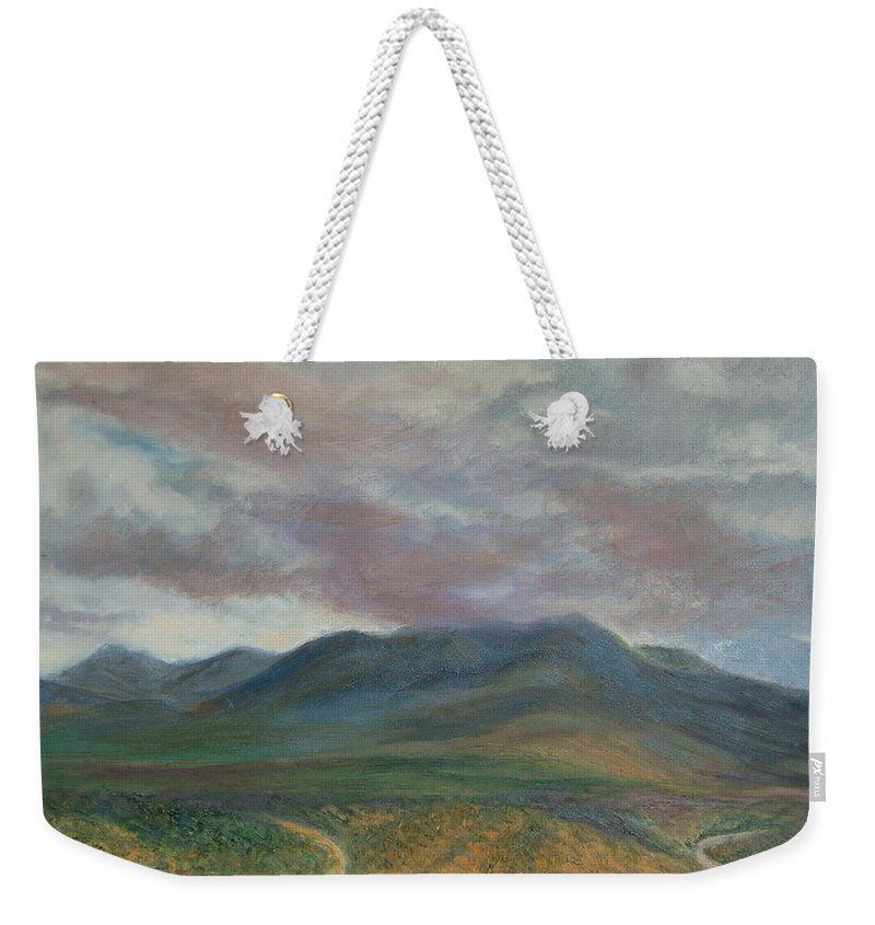 Landscape Weekender Tote Bag featuring the painting Storm Clouds Over the Ortiz Mountains by Phyllis Tarlow