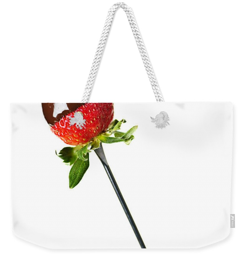 Strawberry Weekender Tote Bag featuring the photograph Strawberry Dipped In Chocolate by Elena Elisseeva