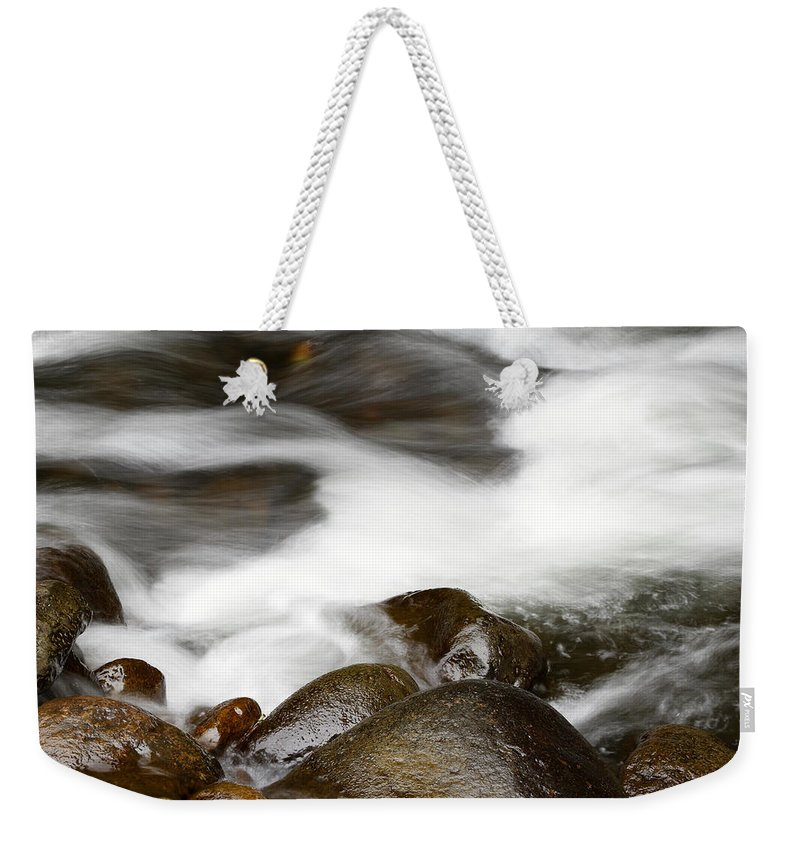 Brook Weekender Tote Bag featuring the photograph Stream Flowing Over Rocks by Les Cunliffe