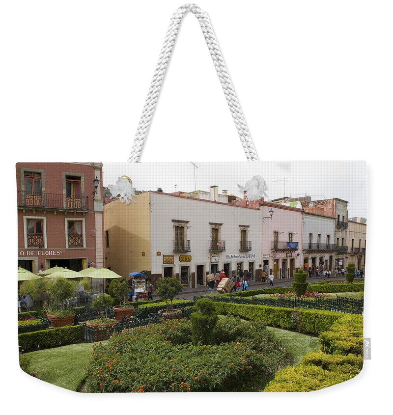 Color Image Weekender Tote Bag featuring the photograph Street Scene In Plaza De La Paz by Krista Rossow