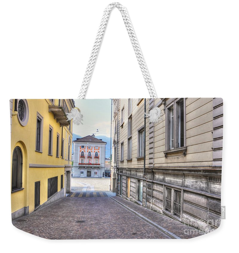 Alley Weekender Tote Bag featuring the photograph Street With Houses by Mats Silvan