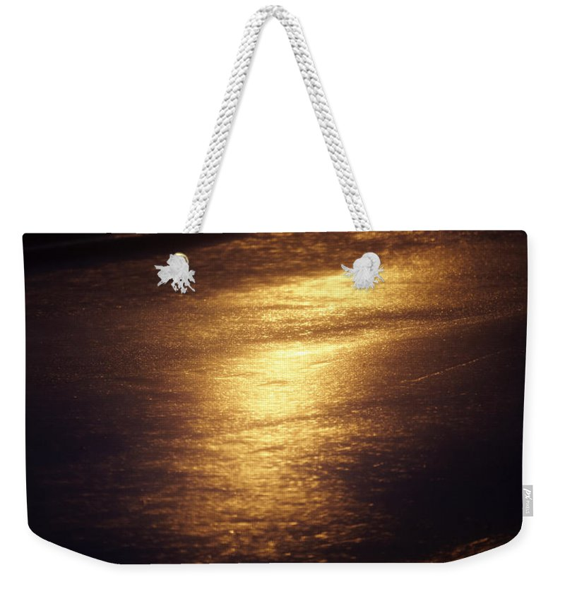 Absence Weekender Tote Bag featuring the photograph Gold Water On The Street by Skip Nall