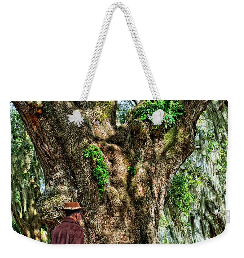 New Orleans Weekender Tote Bag featuring the photograph Strolling With Giants by Steve Harrington