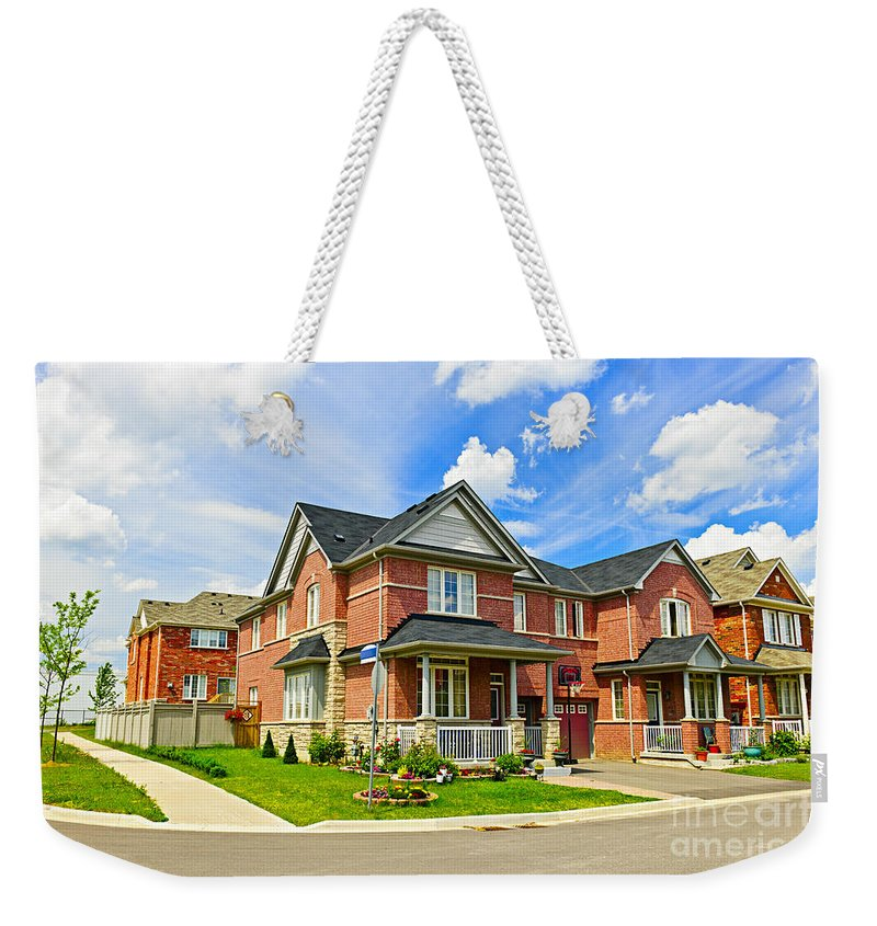Houses Weekender Tote Bag featuring the photograph Suburban Homes by Elena Elisseeva