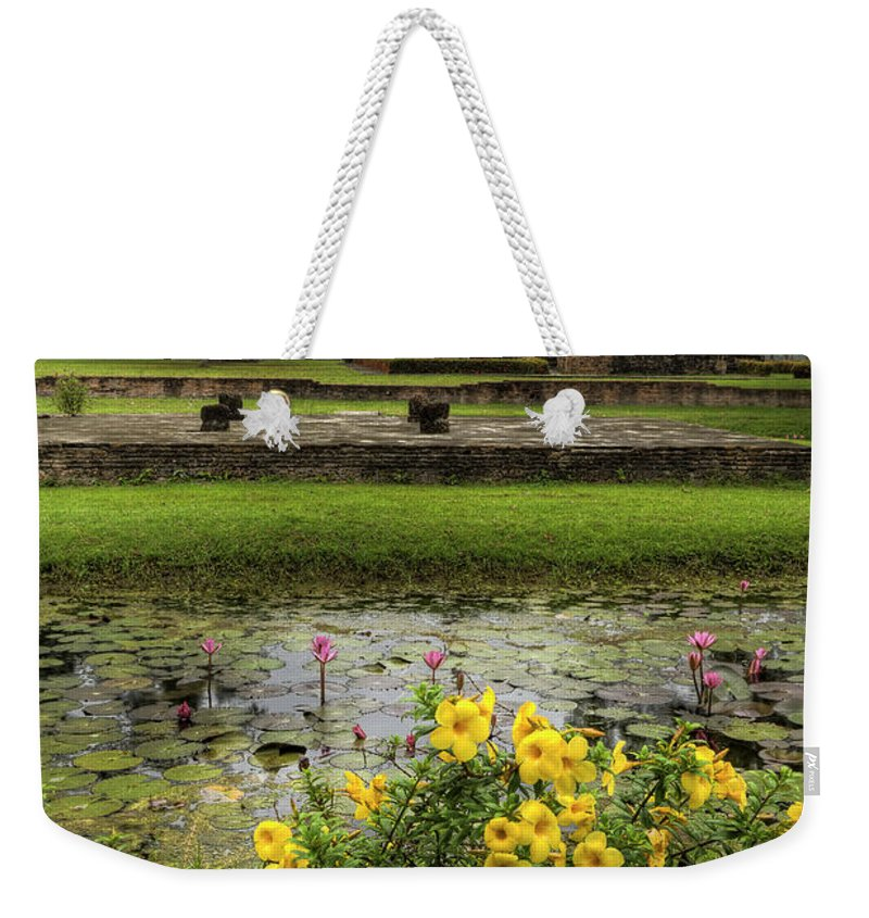 Temple Weekender Tote Bag featuring the photograph Sukhothai Historical Park by Adrian Evans