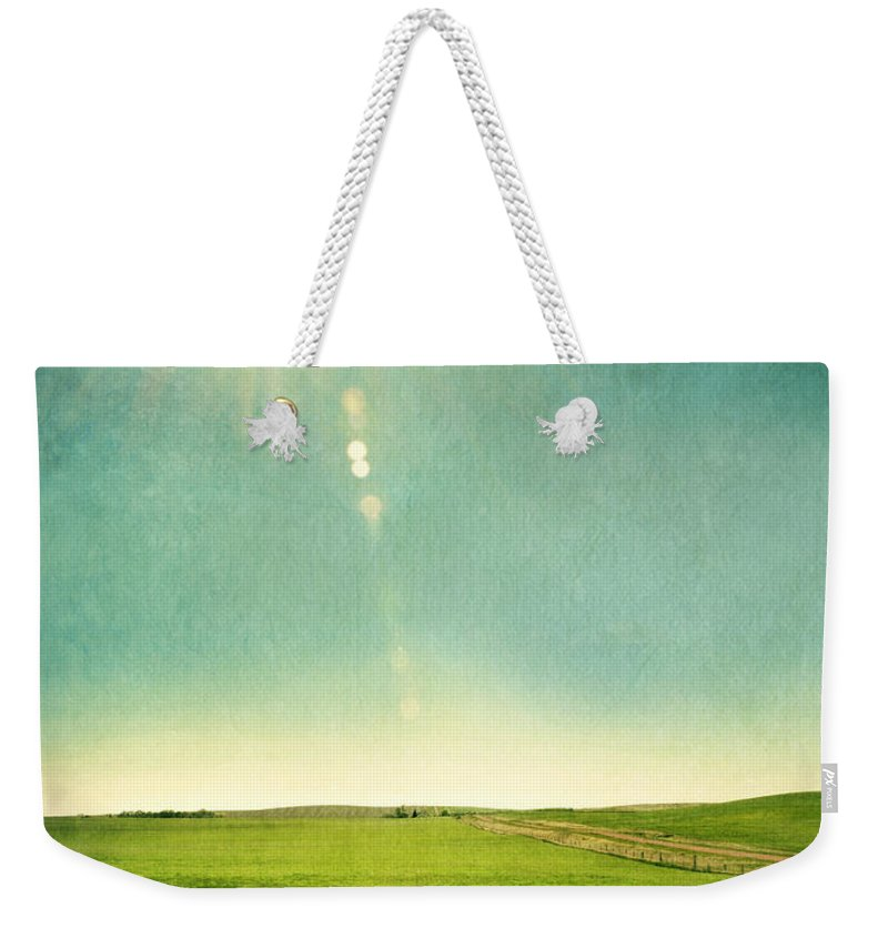 Grass Weekender Tote Bag featuring the photograph Sun Over Field by Jill Battaglia