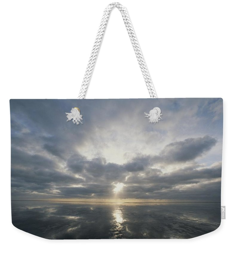 Europe Weekender Tote Bag featuring the photograph Sun Reflection Over Water, Wattenmeer by Norbert Rosing