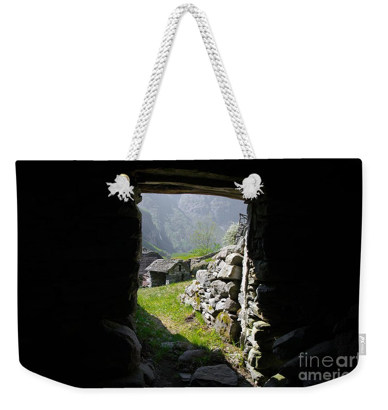 Watching Weekender Tote Bag featuring the photograph Sunlight Coming In by Mats Silvan