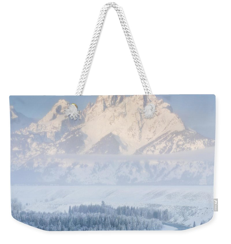 Dawn Weekender Tote Bag featuring the photograph Sunrise Over A Snow-blanketed Landscape by Drew Rush