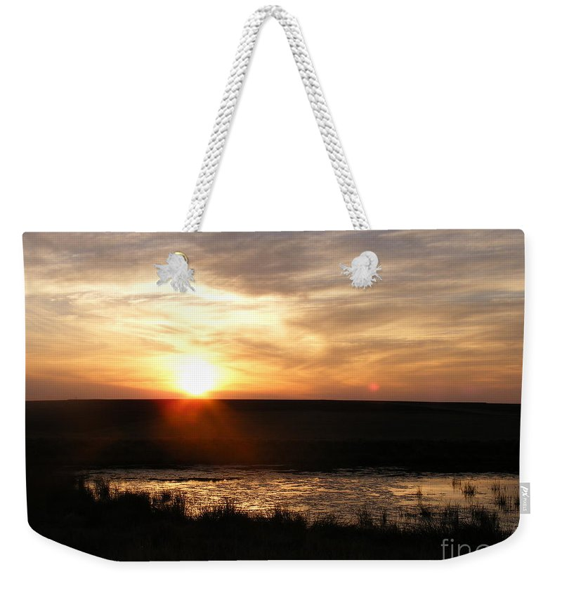 Sunset Weekender Tote Bag featuring the photograph Sunset And Water by Helena Marais