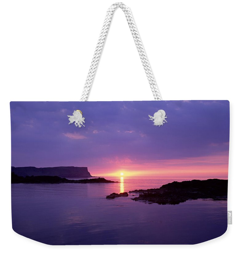 Photography Weekender Tote Bag featuring the photograph Sunset At Benbane Head On The North by Chris Hill