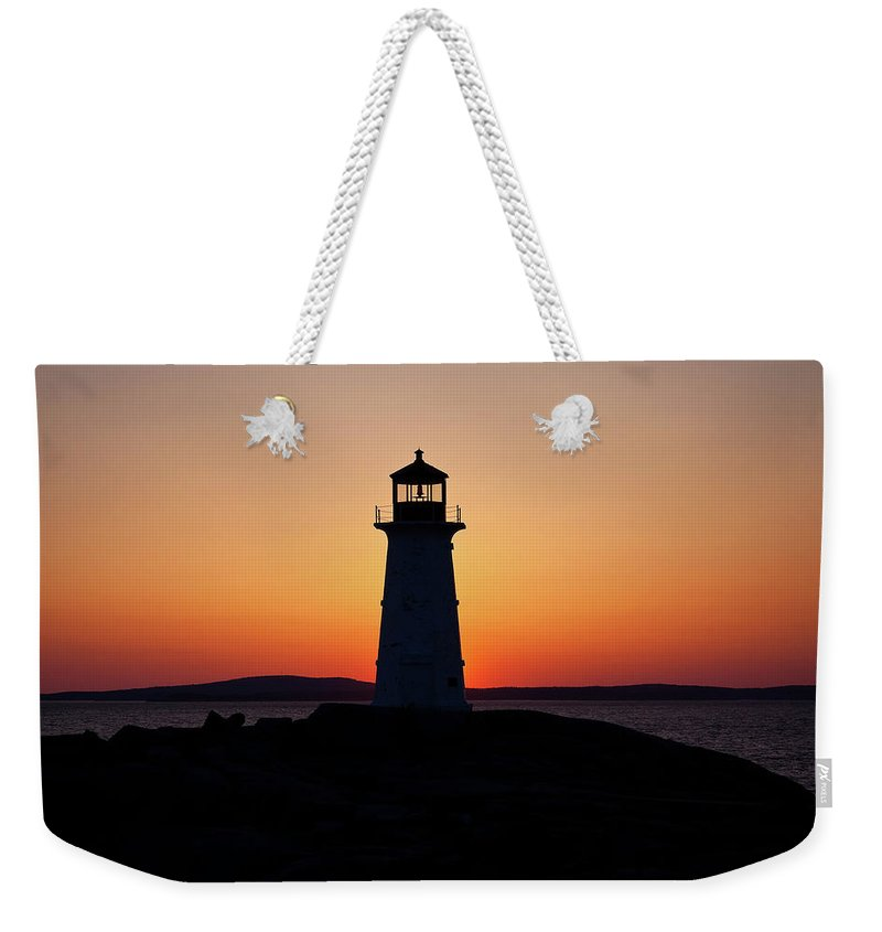 Lighthouse Weekender Tote Bag featuring the photograph Sunset At Peggy's Cove by Bill Lindsay