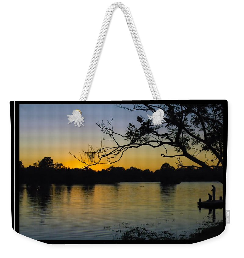 Men On Dock Weekender Tote Bag featuring the photograph Sunset On The Dock by Carolyn Marshall