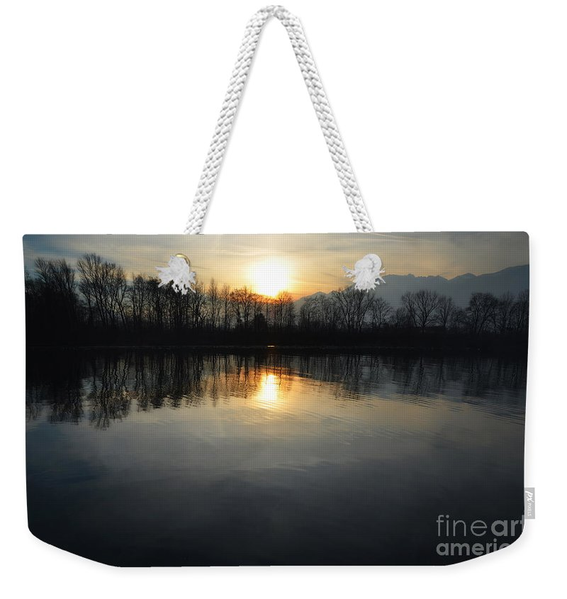 Sun Weekender Tote Bag featuring the photograph Sunset Over A Lake by Mats Silvan