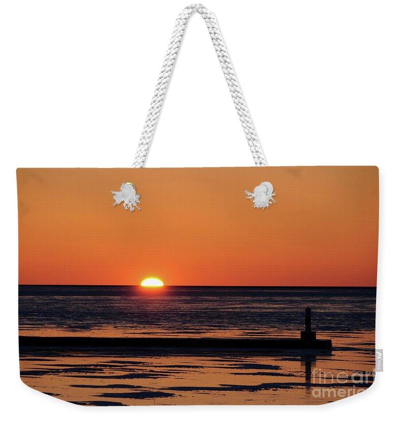 Sunset Weekender Tote Bag featuring the photograph Sunset Park Petoskey Mi by Ronald Grogan