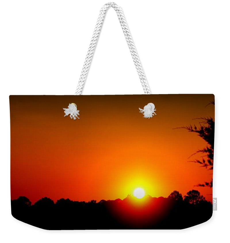 Sunset Weekender Tote Bag featuring the photograph Sunset by Paul Wilford