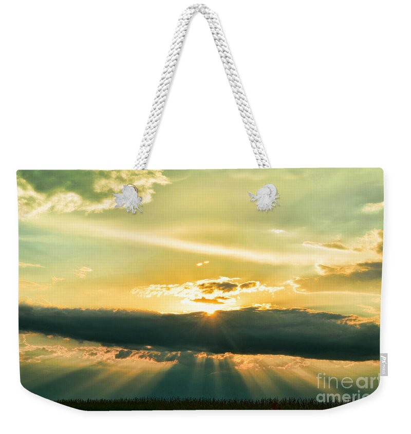 Nature Weekender Tote Bag featuring the photograph Sunset Sunbeams by Debbie Portwood