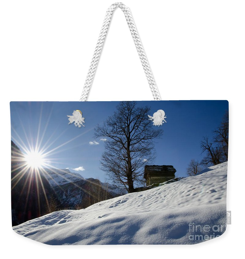 Winter Weekender Tote Bag featuring the photograph Sunshine Over The Snow by Mats Silvan