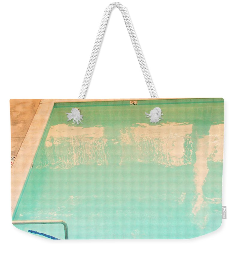 Pool Weekender Tote Bag featuring the photograph Tandem By The Pool by Kathleen Grace