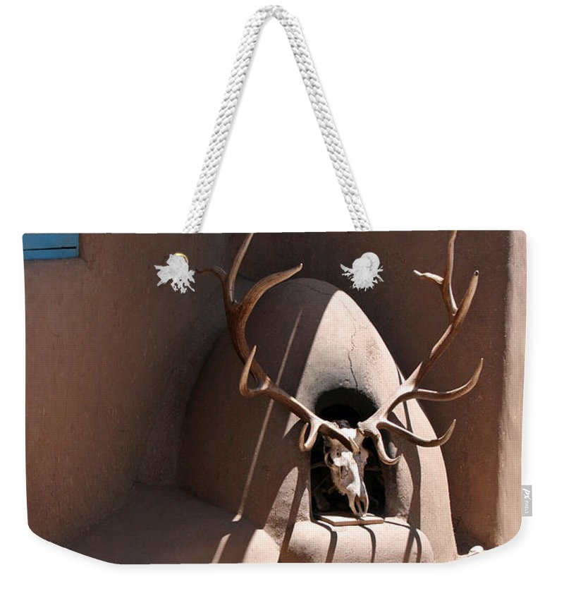 Taos Weekender Tote Bag featuring the photograph Taos Horno And Antlers by Elizabeth Rose