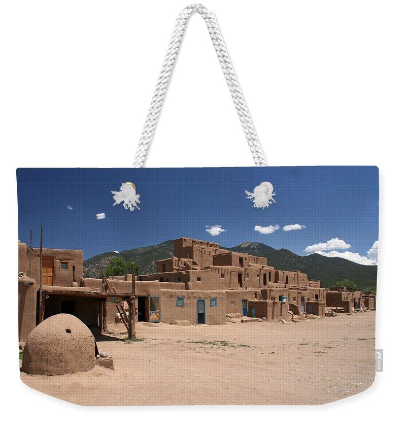 Taos Weekender Tote Bag featuring the photograph Taos Pueblo by Elizabeth Rose