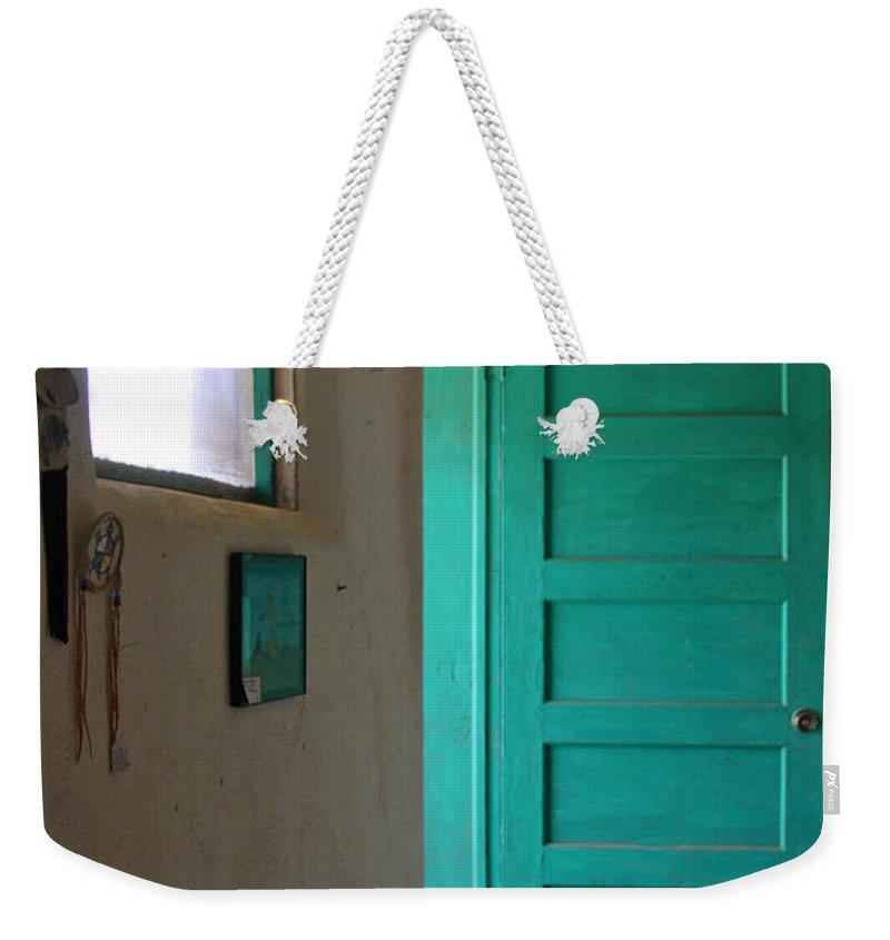 Taos Weekender Tote Bag featuring the photograph Taos Pueblo Shop Door by Elizabeth Rose