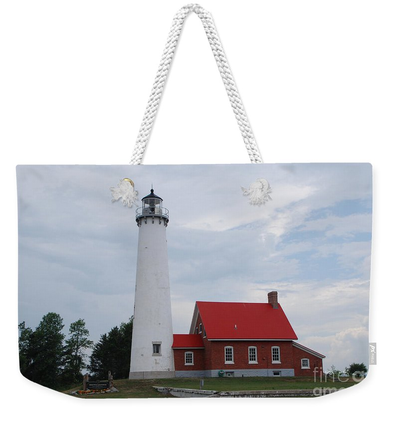 Lighthouse Weekender Tote Bag featuring the photograph Tawas Point Lighthouse by Grace Grogan