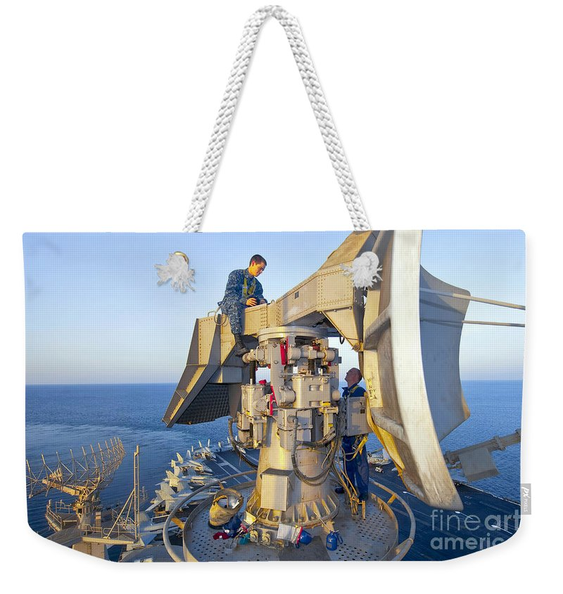 Radar Weekender Tote Bag featuring the photograph Technicians Perform Maintenance by Stocktrek Images