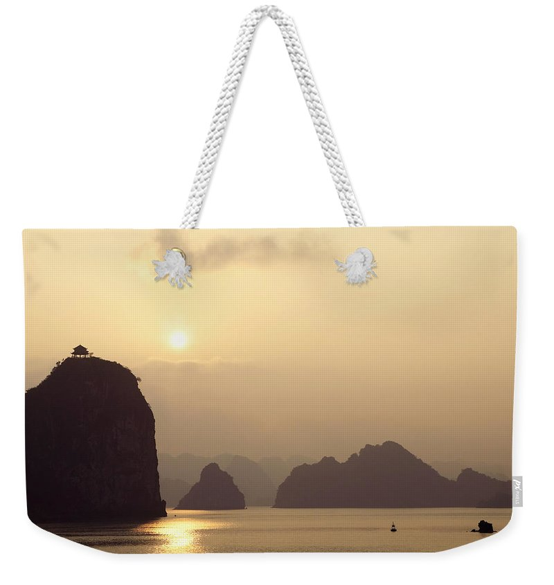 Asia Weekender Tote Bag featuring the photograph Temple At Sunset In Halong Bay by Skip Nall