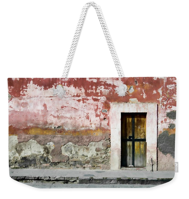 San Miguel De Allende Weekender Tote Bag featuring the photograph Textured Wall In Mexico by Carol Leigh