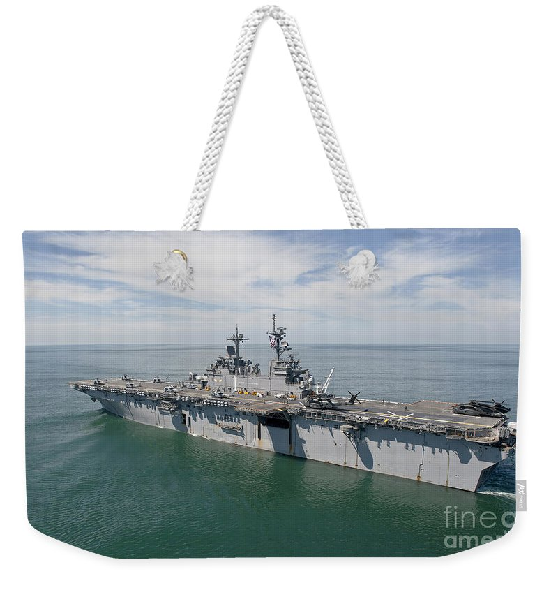 Uss Wasp Weekender Tote Bag featuring the photograph The Amphibious Assault Ship Uss Wasp by Stocktrek Images