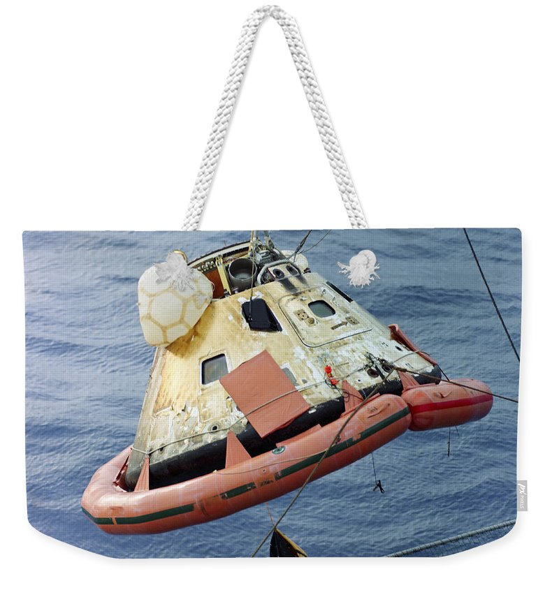 1968 Weekender Tote Bag featuring the photograph The Apollo 8 Capsule Being Hoisted by Stocktrek Images