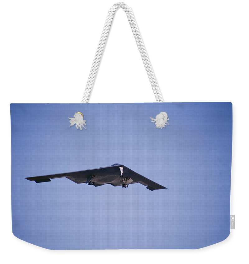 Edwards Air Force Base Weekender Tote Bag featuring the photograph The B-2 Bomber, Also Known by Marc Moritsch