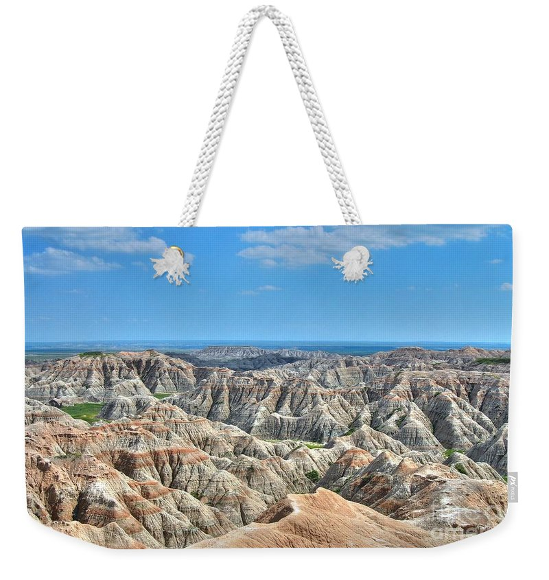 Badlands Weekender Tote Bag featuring the photograph The Badlands by Anthony Wilkening