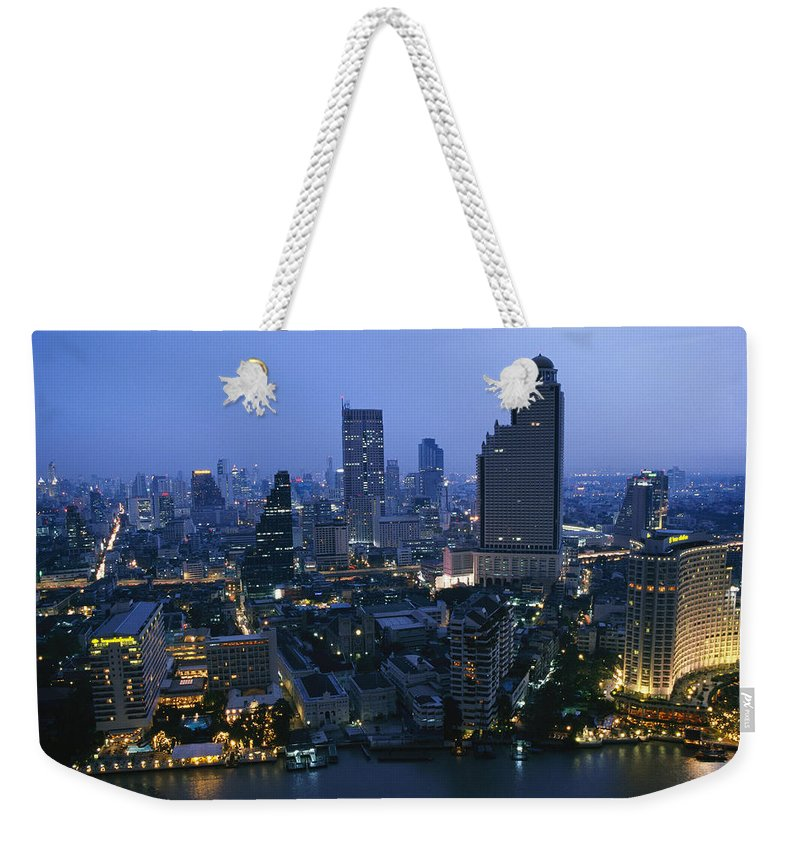 Asia Weekender Tote Bag featuring the photograph The Bangkok Skyline At Dusk by Richard Nowitz