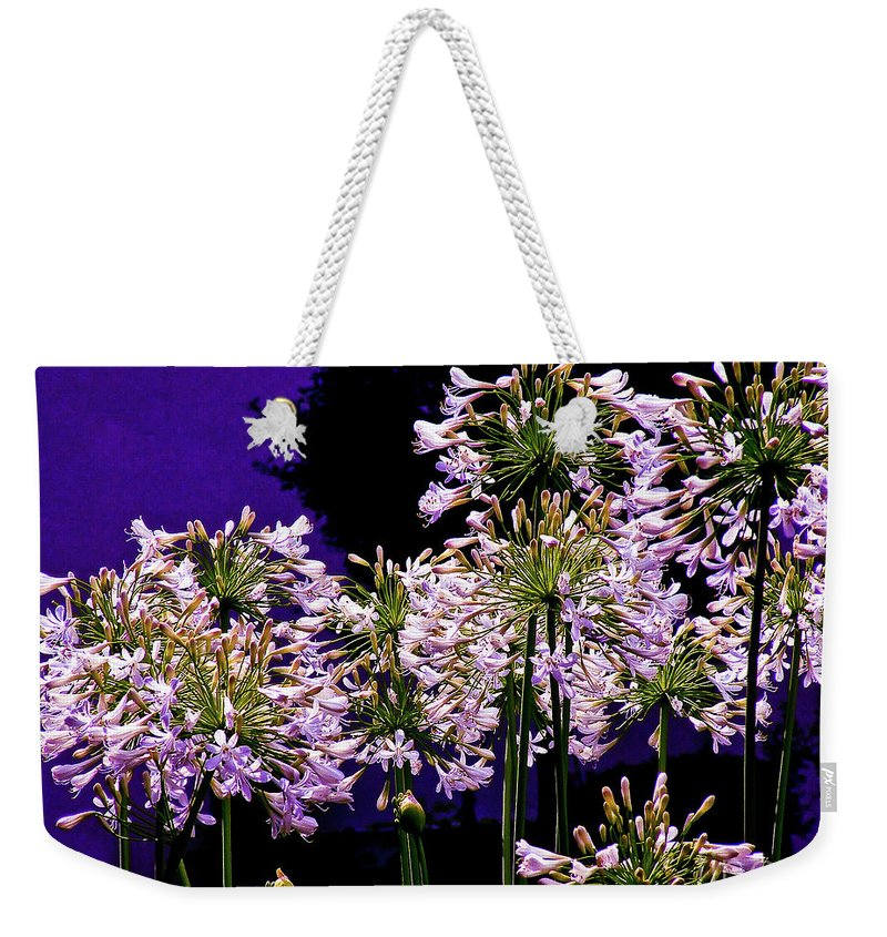 Flower Weekender Tote Bag featuring the photograph The Beauty Of Flowering Garlic by Frances Hattier