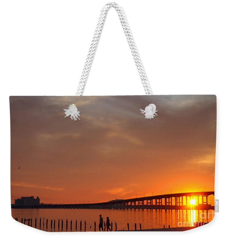 United States Weekender Tote Bag featuring the photograph The Biloxi Bay Bridge At Sunset by David R Frazier and Photo Researchers