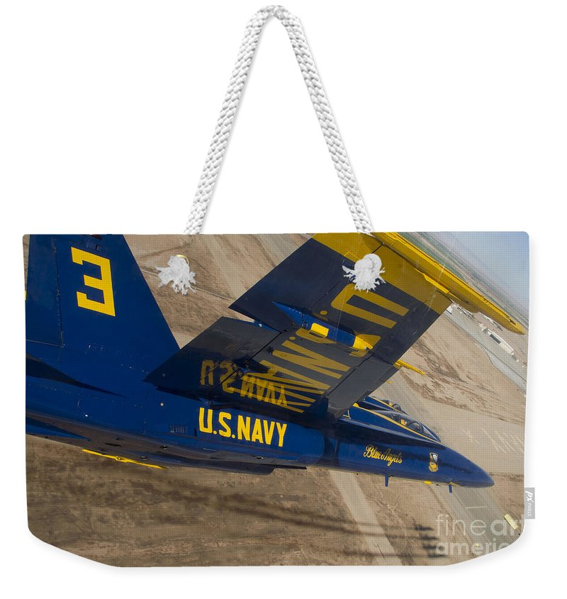 Military Weekender Tote Bag featuring the photograph The Blue Angels Perform Over El Centro by Stocktrek Images