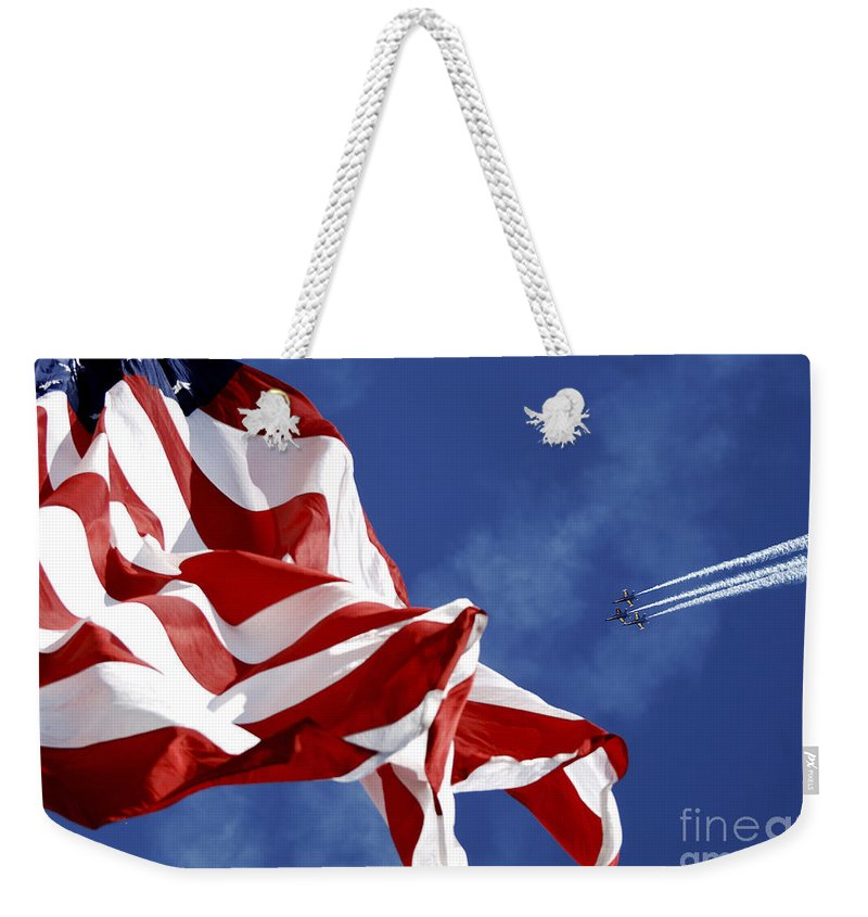 United We Stand Weekender Tote Bag featuring the photograph The Blue Angels Performing At An Air by Stocktrek Images