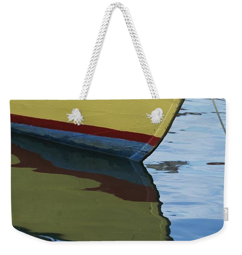 Boats Weekender Tote Bag featuring the photograph The Bow Of An Anchored, Striped Boat by Michael Melford