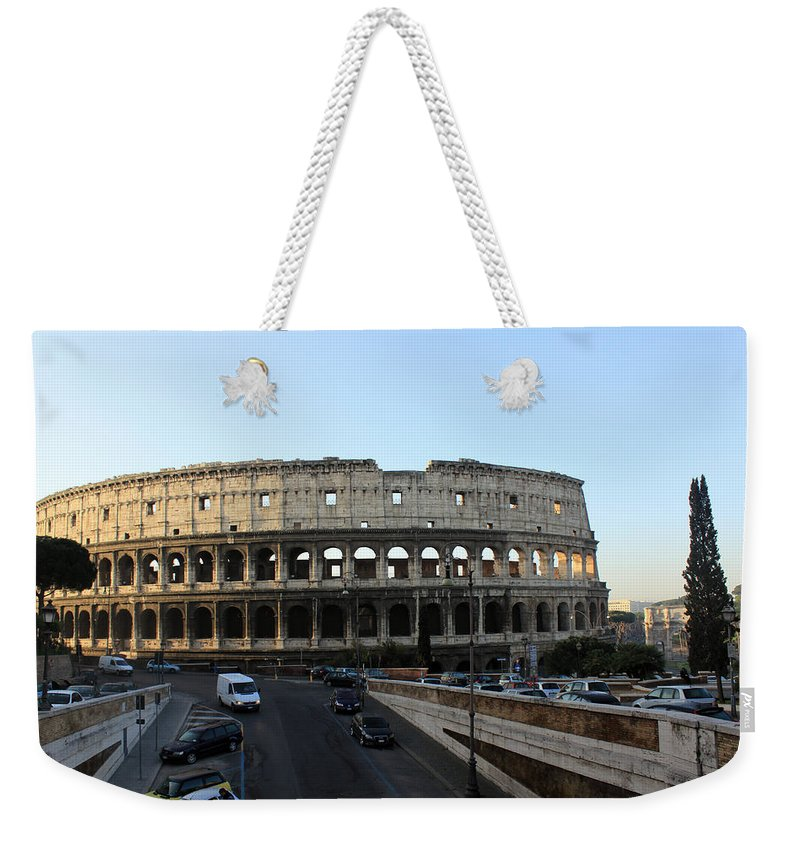 Rome Weekender Tote Bag featuring the photograph The Colosseum in Rome by Munir Alawi