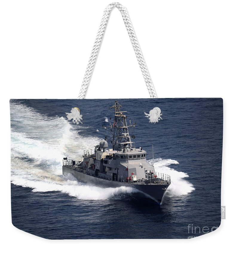 Cyclone Class Patrol Ship Weekender Tote Bag featuring the photograph The Cyclone-class Coastal Patrol Ship by Stocktrek Images