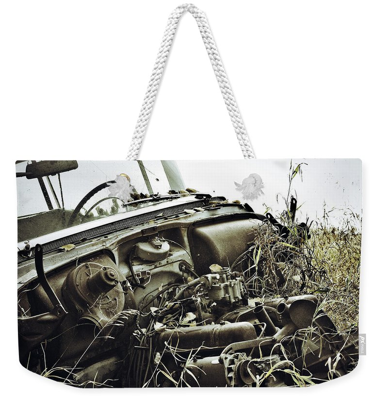 Street Photographer Weekender Tote Bag featuring the photograph The Dirts Hold by The Artist Project