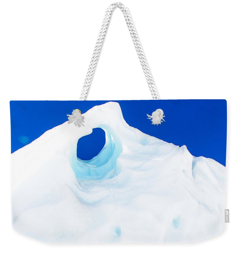 Glacier Weekender Tote Bag featuring the photograph The Eye Of The Glacier by John White
