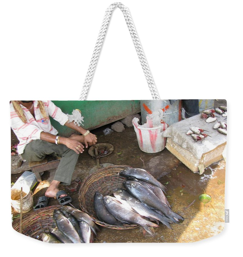 Fish Weekender Tote Bag featuring the photograph The Fish Seller by David Pantuso