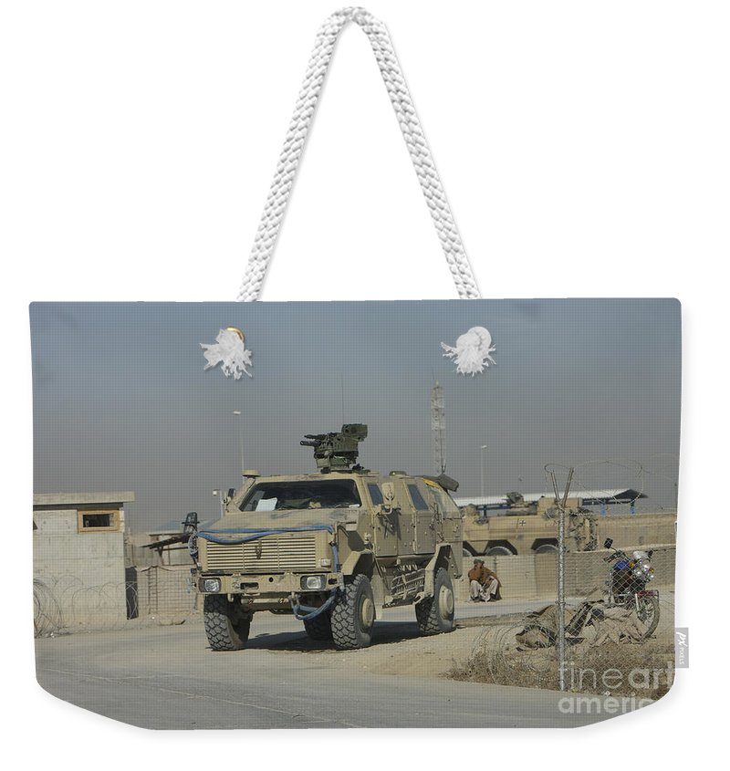 Mrap Weekender Tote Bag featuring the photograph The German Army Atf Dingo With A Turret by Terry Moore