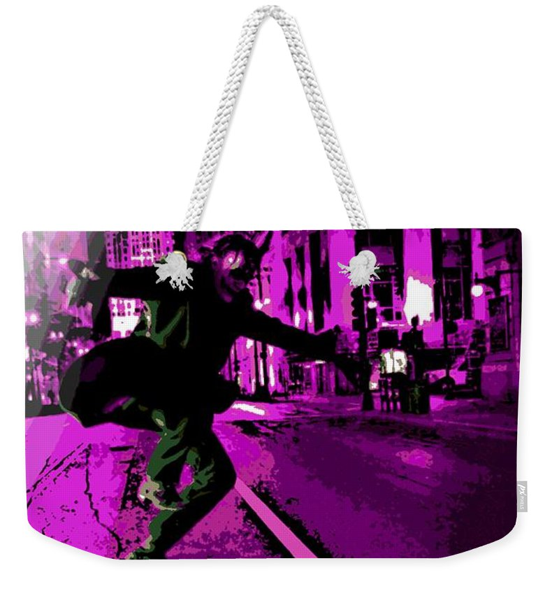 Joker Weekender Tote Bag featuring the photograph the Joker about to Pounce by George Pedro